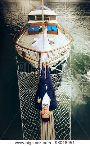 Stylish Young Groom Lying On The Sternthe Yacht Montenegro On Board The Yacht Montenegro