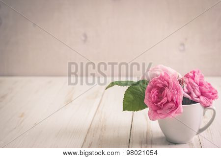Pink Tea Roses On A White Wooden Background