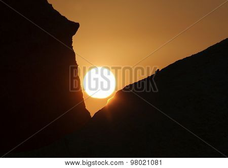 Rising Sun Among Two Rocks