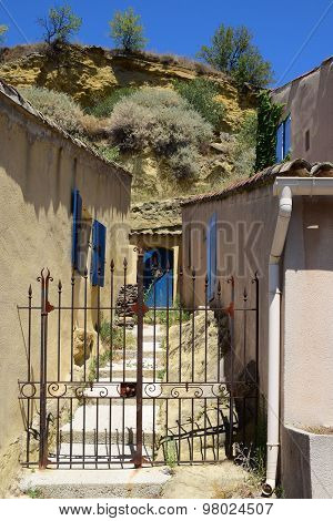 Garden Gate Between Typical Houses In A Small Mountain Village, South Of Europe