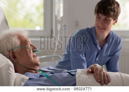 Grandson Visiting Ill Grandfather
