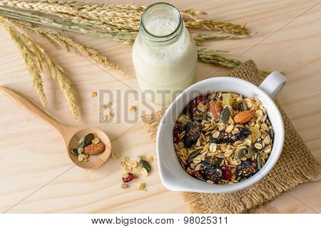 Bottle Of Fresh Milk With Oat And Whole Wheat Grains Flake