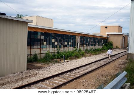 Railroad Track Between Buildings