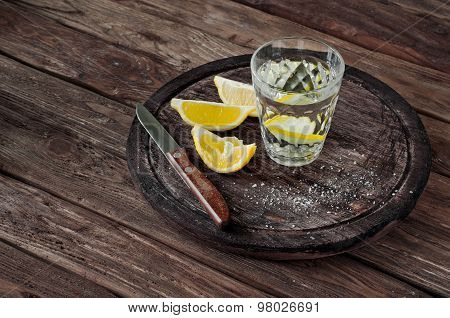 Glass Of Tequila With Lemon Slices