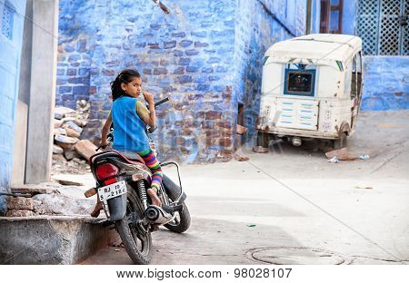 Girl On The Bike In Blue City