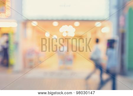 Blurred Shopping Mall Store Front With Women Walking