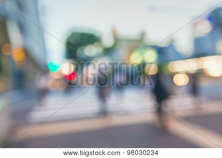 Blurred Street Intersection In A Big City With People At Night