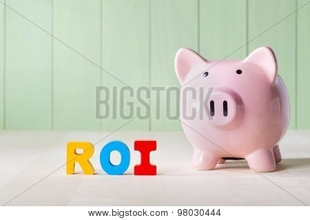 Roi Theme With Wood Block Letters And Piggy Bank