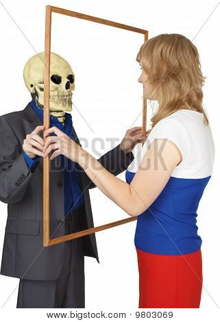 Woman Looks At Skeleton As Reflected