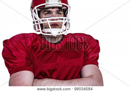 American football player with arms crossed on a white background