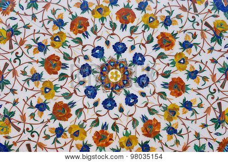 Exterior of the traditional floral marble design produced by muslim Bharai community in Agra, India.