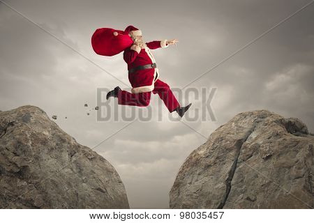 Santa Claus jumping on rocks