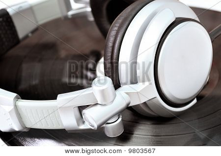 Dj Headphones Lying Over Black Vinyl