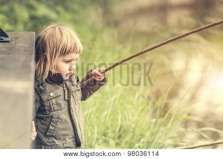 fisher girl carefully looking after the fishing rod