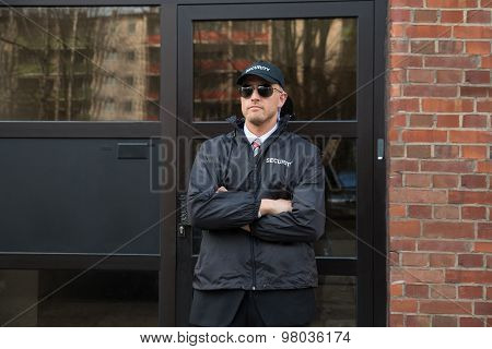 Security Guard Standing In Front Of The Entrance