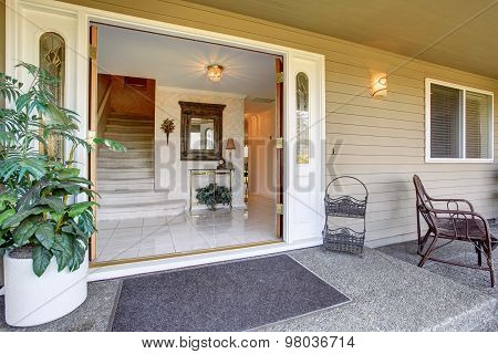 Front Door Of Amazing Home With Shrubbery.