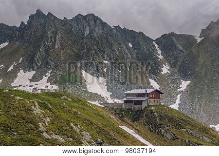 Mountain Scenery With Cottage