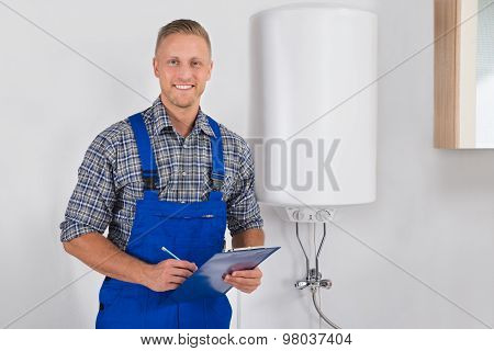 Plumber Holding Clipboard And Pen