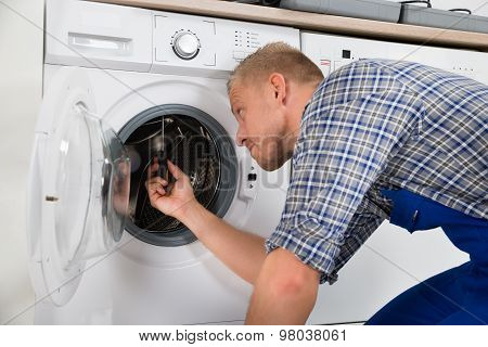 Repairman Repairing Washer