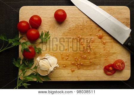 Preaparation Cherry Tomatoes With Chefs Knife On Wood Cutting Board