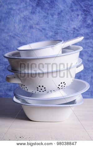 Stack Of Enamel Kitchen Bowls And Pans.