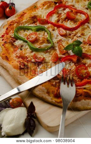 Delicious, Freshly Baked, Homemade Italian Pizza With Peppers, Onions And Tomatos