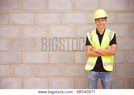 Portrait Of Male Construction Worker On Building Site