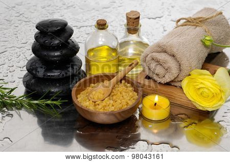 Spa set with salt in spoon, towel, candle ,oil, orchid ,stones