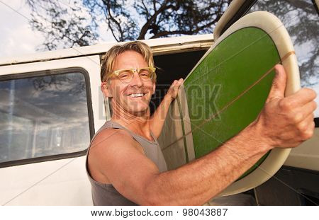 Happy Man Removing Surfboard