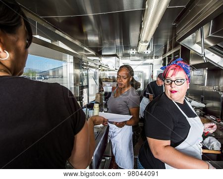 Preparing Food On Busy Food Truck