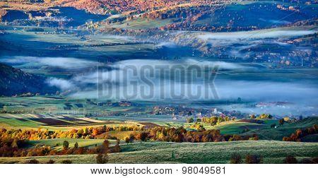 beautiful mountain landscape in foggy morning