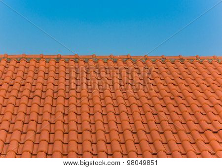 roof tile pattern over blue sky.