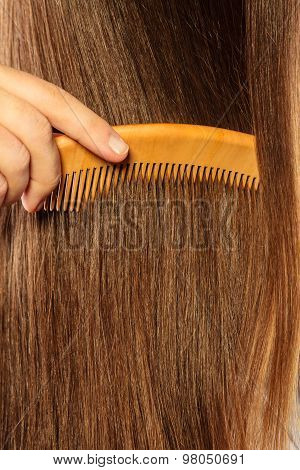 Hair Background And Hand With Comb