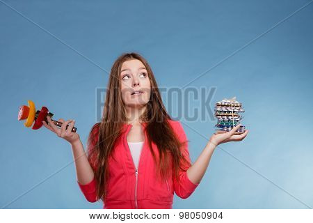 Woman Holding Pills And Vegetables. Health Care