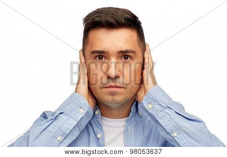 problem, emotion, stress, hearing problem and people concept - face of middle aged latin man covering his ears with hand palms