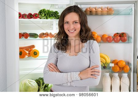 Woman With Armcrossed In Front Of Fridge