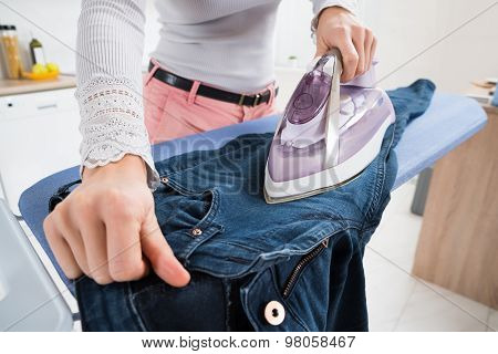 Woman Ironing Jeans