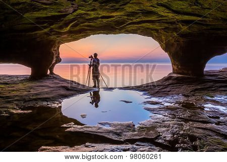 Sea Cave Photographer At Sundown