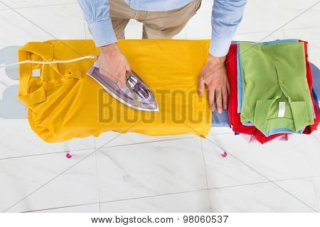 Man Ironing Yellow T-shirt
