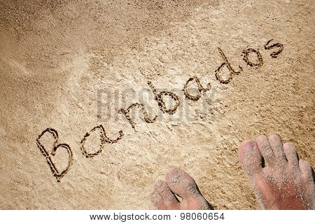 Barbados handwritten in sand for natural, symbol, tourism or conceptual designs background with feet