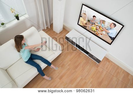 Girl Holding Remote Control In Front Of Television