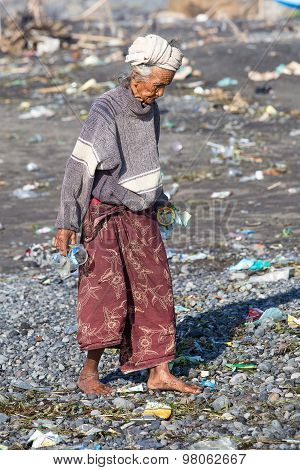 Old Poor Woman To Bali Island. Indonesia