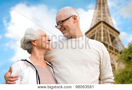 family, age, tourism, travel and people concept - happy senior couple over paris eiffel tower in france