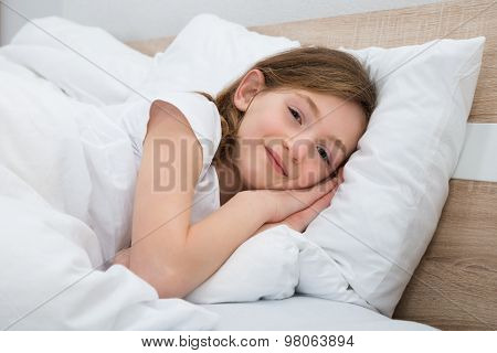 Happy Girl Lying In Bed