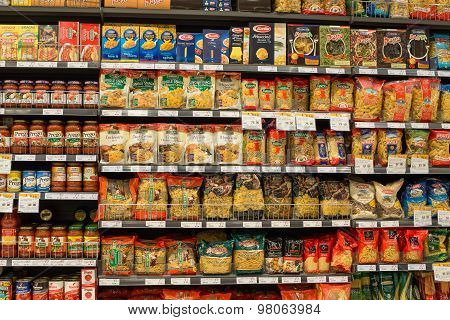 Selection of italian pasta on the shelves in a supermarket Siam Paragon Bangkok.