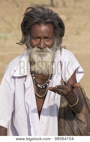 Old Indian Beggar Waits For Alms On A Street. Pushkar, India
