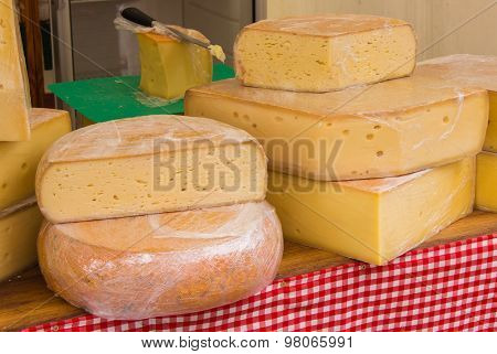 Blocks Of Fresh Yellow Cheese For Sale On Stall