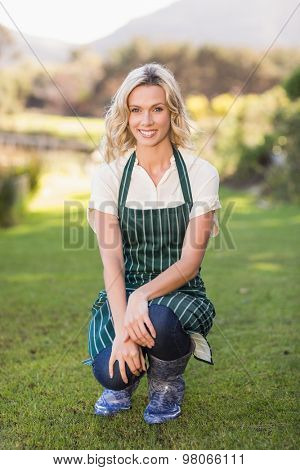 Portrait of a kneeling farmer woman with an apron