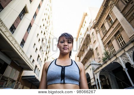 A focused woman looking away on a sunny day