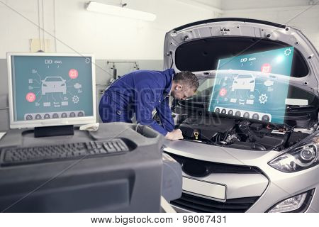 Engineering interface against mechanic examining an engine of a car